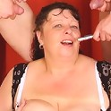 The young guys with the camera use her mature mouth and pussy at the same time