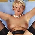Blonde naughty grandma unveils it all