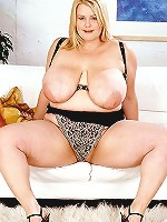 Naughty lass with big natural tamales strips off black tit pant and undies.