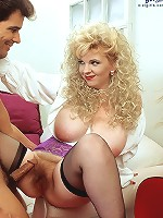 Naugty brunet in panties and tights showing her big boulders.