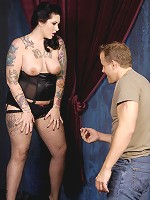 What starts out as a sultry photo op soon turns even sexier. Madison Mitchell shows off a inked up body so irresistible beneath her lacy corset that even the cameraman can't resist.