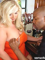 This busty blonde sure knows how to work a chocolate cock!