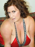 During the day, Nikki Cars is the soccer mom you want to flirt with at a traffic light... Or the cleavage baring housewife you see at the grocery store. But at night, or any time she can get away with it, she is your ultimate fantasy